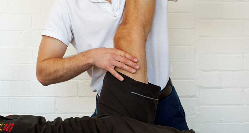 Craig Brown, CBPhysio with a client - understanding knee pain